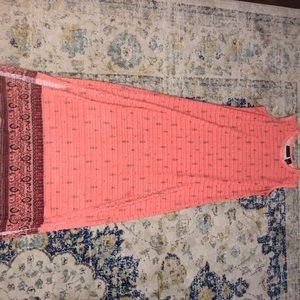 A beautiful fairly worn sleeveless dress